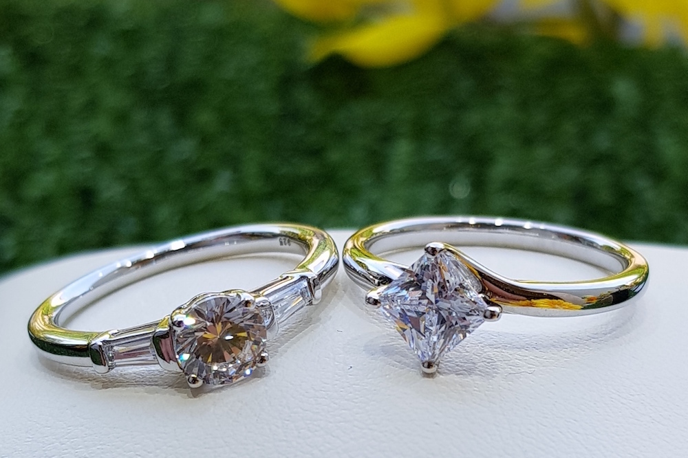Two solitaire diamond rings