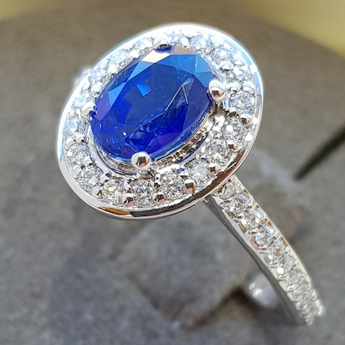 Oval blue halo sapphire and diamond cocktail ring